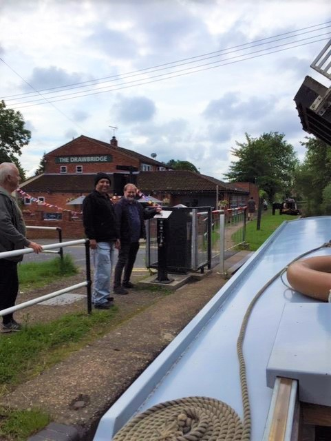 Kamal and Jon at the edge of the longboat outside The Drawbridge pub